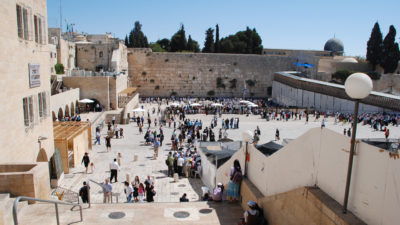 The Wailing wall, with the Dome of the Rock peeping over top right
